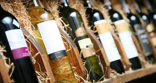 shutterstock_winebottlesincratecrop1